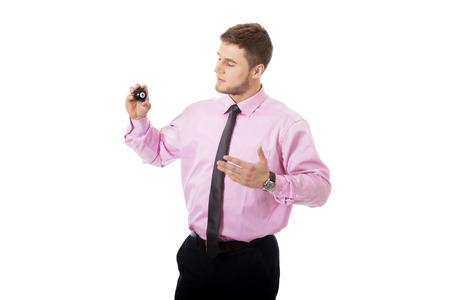 billiard ball: Young handsome businessman showing billiard ball.