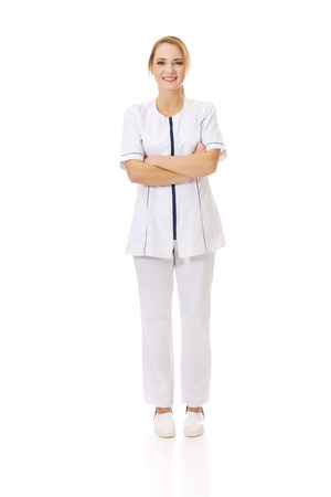 folded arms: Young female doctor or nurse with folded arms.