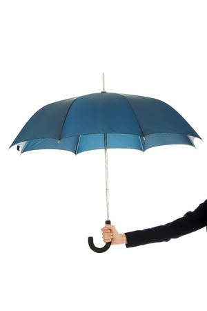 busineswoman: Business womans hand is holding blue umbrella. Stock Photo