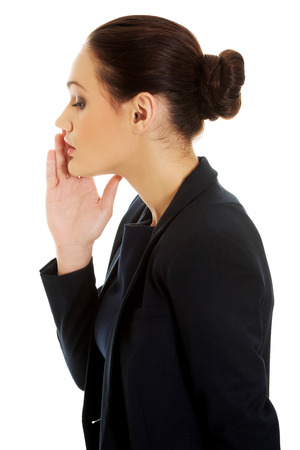 hearsay: Beautiful businesswoman whispering to someone.