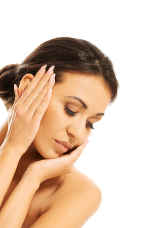 Slim spa woman touching her face photo