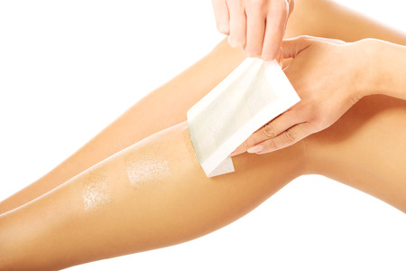 Spa woman waxing her leg Stock Photo