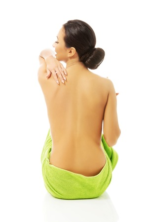 naked woman sitting: Back view woman sitting wrapped in towel. Stock Photo