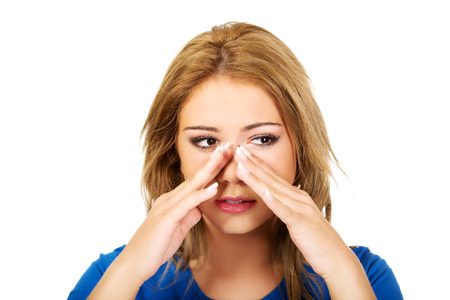 sinus: Beautiful young woman with sinus pressure pain.