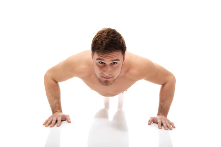Handsome athletic bodybuilder doing pumps. photo