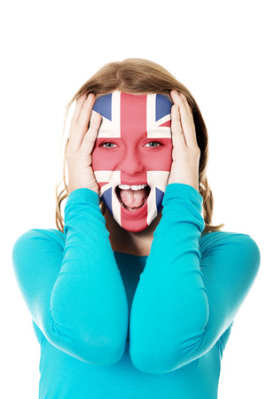 great britain flag: Woman with Great Britain flag painted on face.