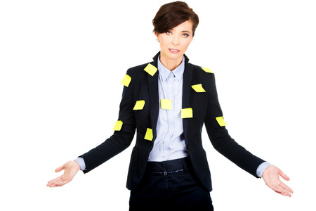 undecided: Businesswoman with adhesive cards showing undecided gesture.