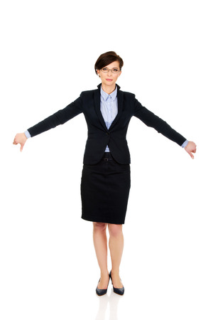 disgruntled: Modern business woman showing thumbs down.