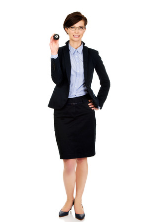 billard: Businesswoman in glasses holding eight billiard ball.