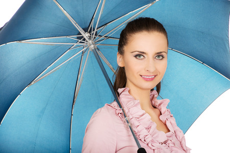 Beautiful business woman is holding blue umbrella. photo