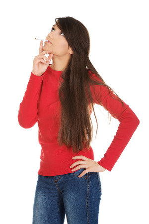 one young woman: Young student woman smoking cigarette.