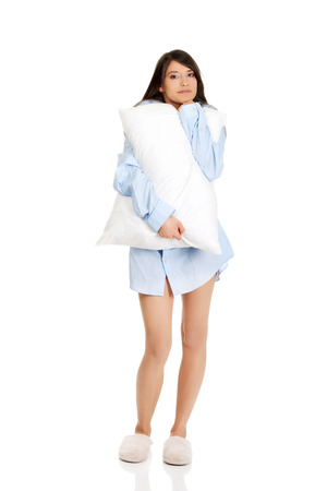wellness sleepy: Young morning woman in big shirt and pillow. Stock Photo
