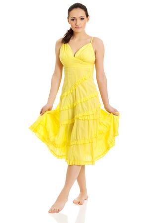 Beautiful young woman in yellow summer dress. Stock Photo