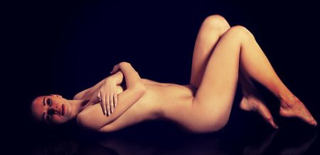 nude young woman: Sensual nude young woman in black Stock Photo
