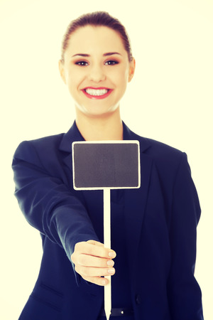 advertising board: Happy businesswoman holding small empty advertising board