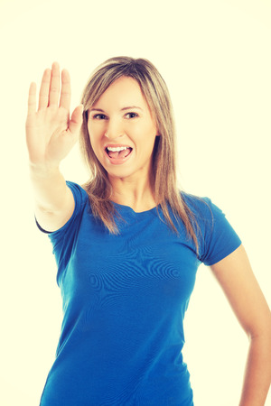 hand stop: Angry woman gesturing stop sign. Stock Photo