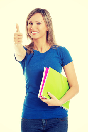 holding notes: Portrait of woman holding notes showing thumbs up.