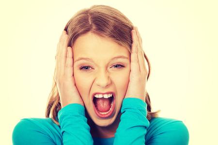angry teenager: Young angry teenager screaming loud