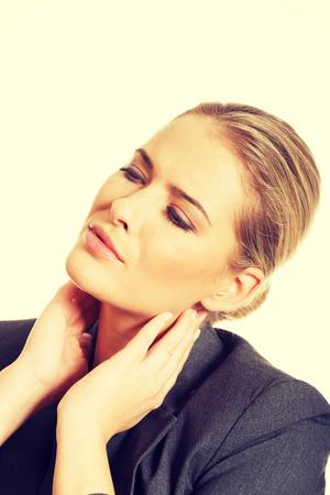 scandinavian descent: Businesswoman having huge neck pain