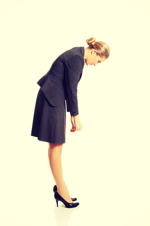 bending down: Businesswoman bending down and searching