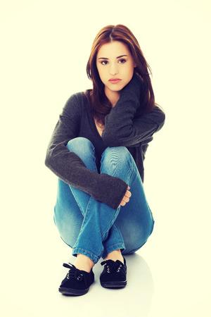legged: Young pretty woman sitting legged
