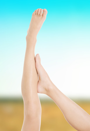 nude women: Beautiful female legs after depilation. Stock Photo