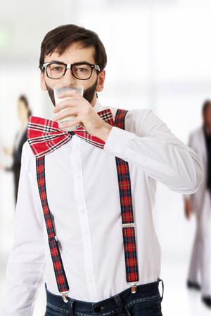 suspenders: Funny man wearing suspenders drinking milk. Stock Photo