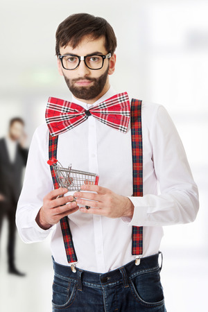 suspenders: Funny man wearing suspenders with small shopping basket.