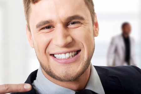 Laughing businessman showing his perfect white teeth.