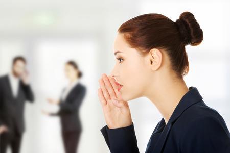 slander: Young business woman talking gossip