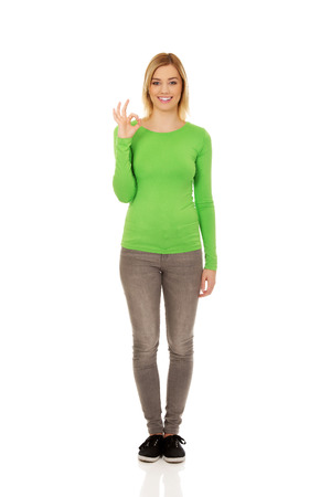 perfect sign: Casual young woman showing the perfect sign. Stock Photo