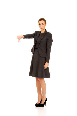 indignant: Modern business woman showing thumbs down.