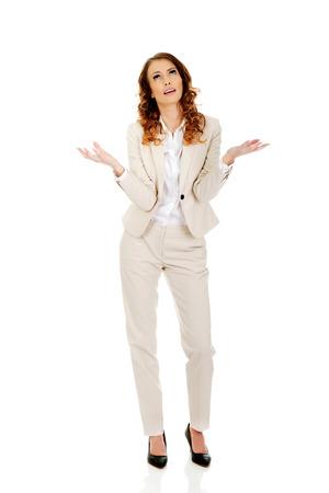 ind�cis: Femme d'affaires faisant le geste ind�cis. Banque d'images
