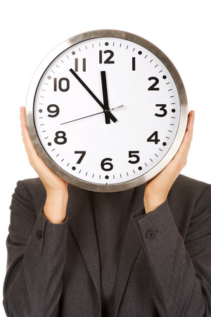 covering face: Business woman covering face with clock. Stock Photo