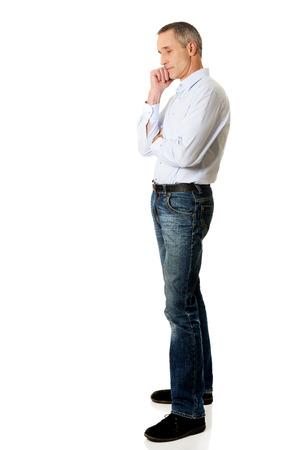 chin: Pensive mature man touching chin. Stock Photo