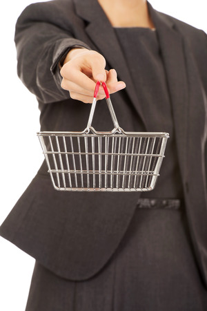 attractive businesswoman: Attractive businesswoman with shopping cart. Stock Photo