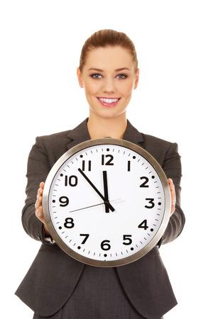 oversleep: Happy businesswoman with a clock. Stock Photo