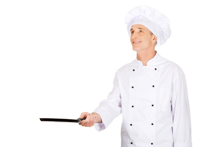non uniform: Experienced restaurant chef with frying pan