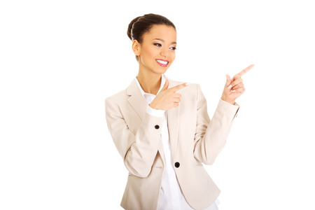 pointing up: Happy african businesswoman pointing up. Stock Photo