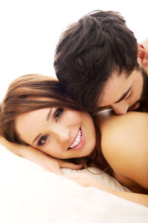 sexy woman on bed: Young love couple in bed, romantic scene in bedroom.