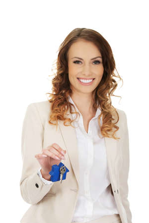 real estate house: Businesswoman real estate agent giving keys.
