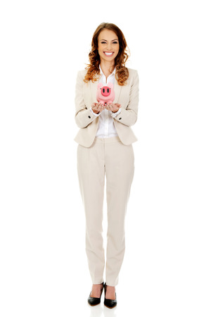 coinbank: Happy business woman with a piggybank.