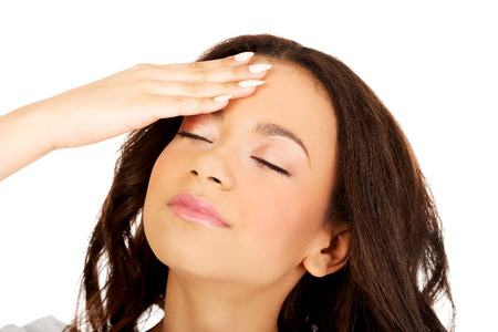 African teen with a headache holding head. photo
