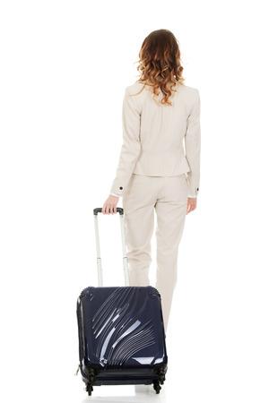 wheeled: Businesswoman dragging heavy wheeled suitcase. Stock Photo