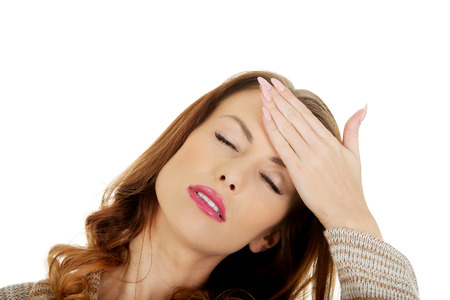 head pain: Woman suffering from head pain. Stock Photo