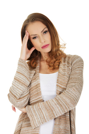 holding on head: Casual depressed woman holding head. Stock Photo