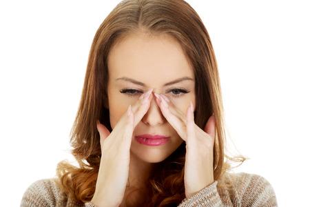 sinus: Woman suffering from sinus pressure pain.