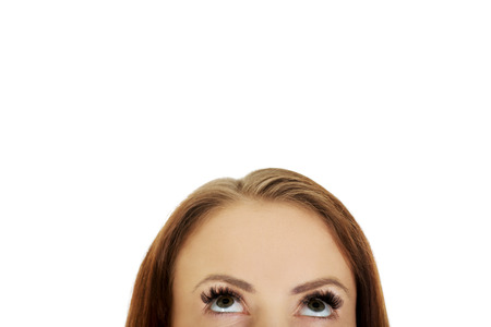 looking up: Beautiful female eyes looking up. Stock Photo