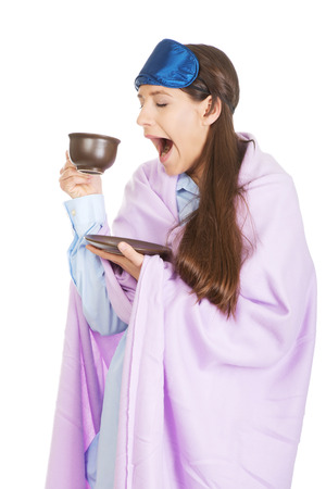 coverlet: Morning woman wrapped in coverlet drinking coffee. Stock Photo