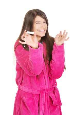 woman bathrobe: Caucasian woman in pink bathrobe with tampon.
